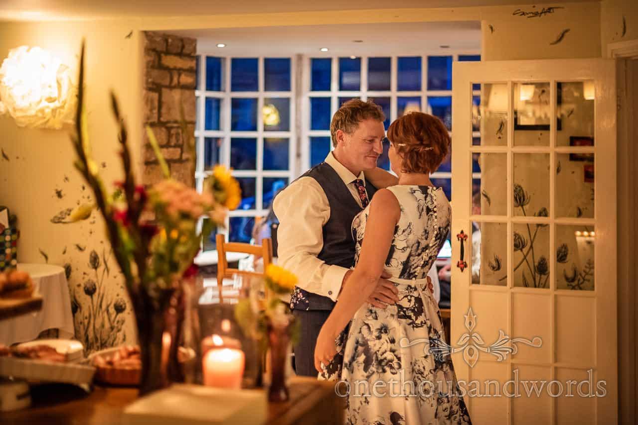 Intermate dance between bride and groom by Dorset wedding photographers