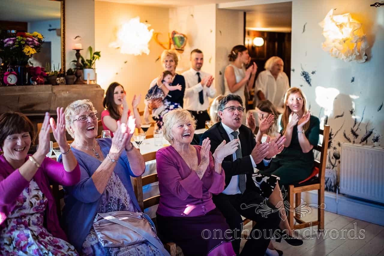 Wedding guests applaud first dance in Dorset restaurant