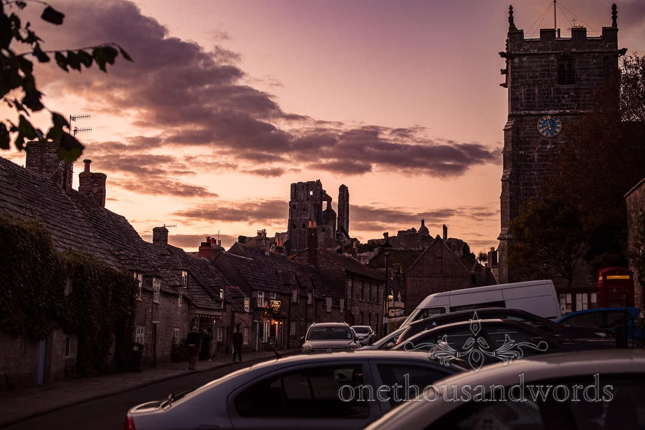 Corfe Castle sunset photograph with church tower and red phone box