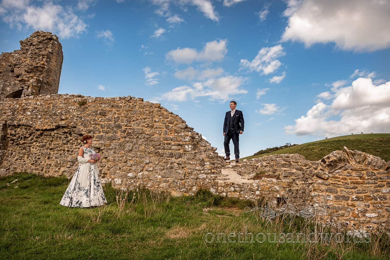 Bride and groom couple photograph taken in the grounds of Corfe Castle wedding photographs