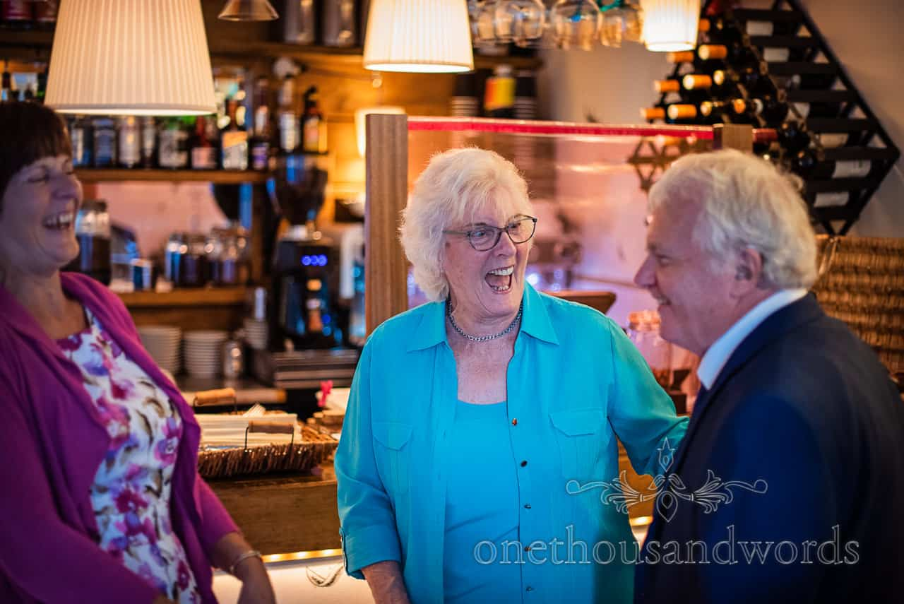 Elderly wedding guests laughing at restaurant evening reception