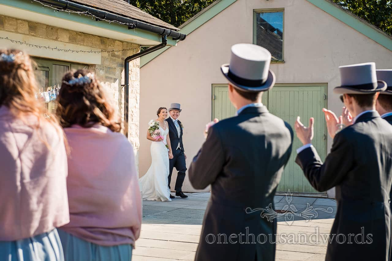 Bride and groom are welcomed to their village hall wedding photographs