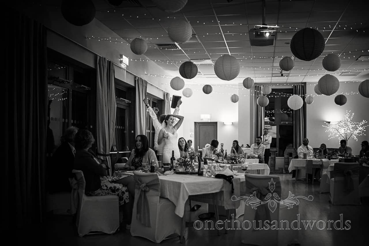 Black and white village hall wedding photographs in evening