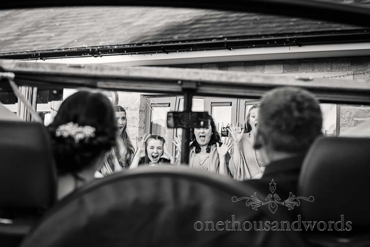 Bride and groom run over their bridesmaids in wedding car