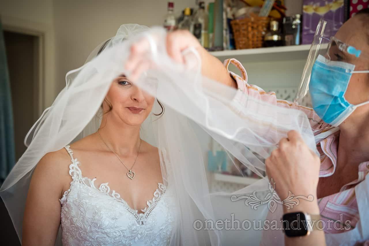 Bride portrait photograph captured under white wedding veil