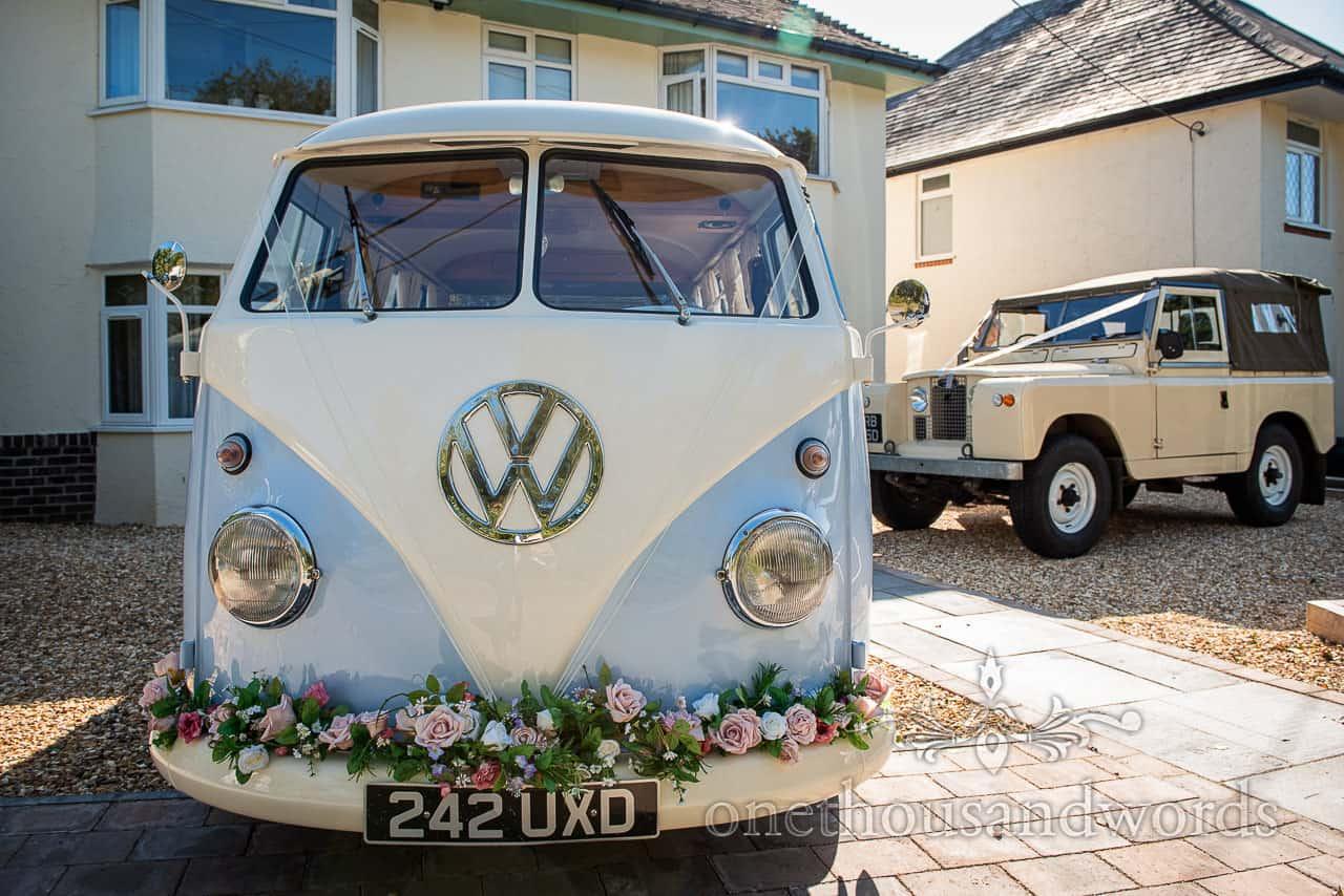 Classic split screen VW campervan and Type 2 Landrover wedding car transport