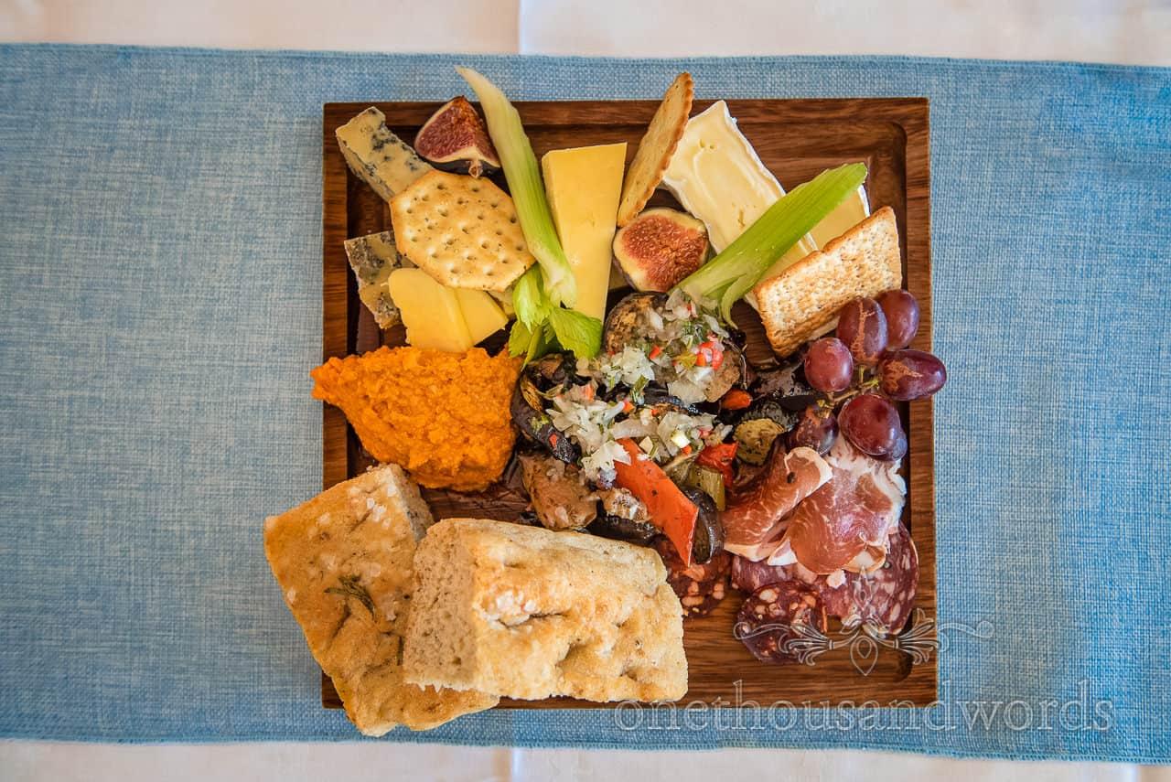 Cold platter mezze wedding food on square wooden board