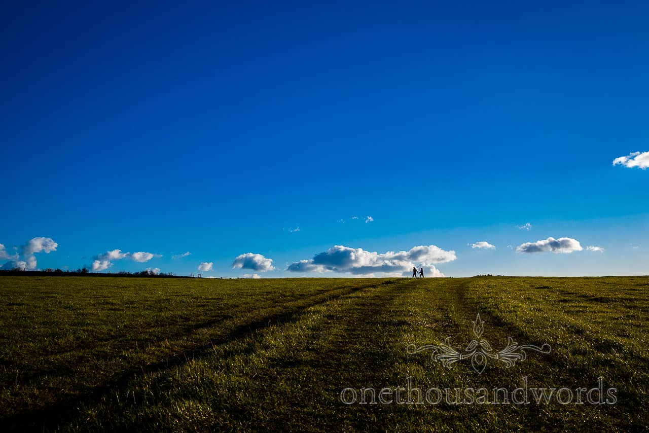 Swyre Head engagement photographs with green fields and blue sky
