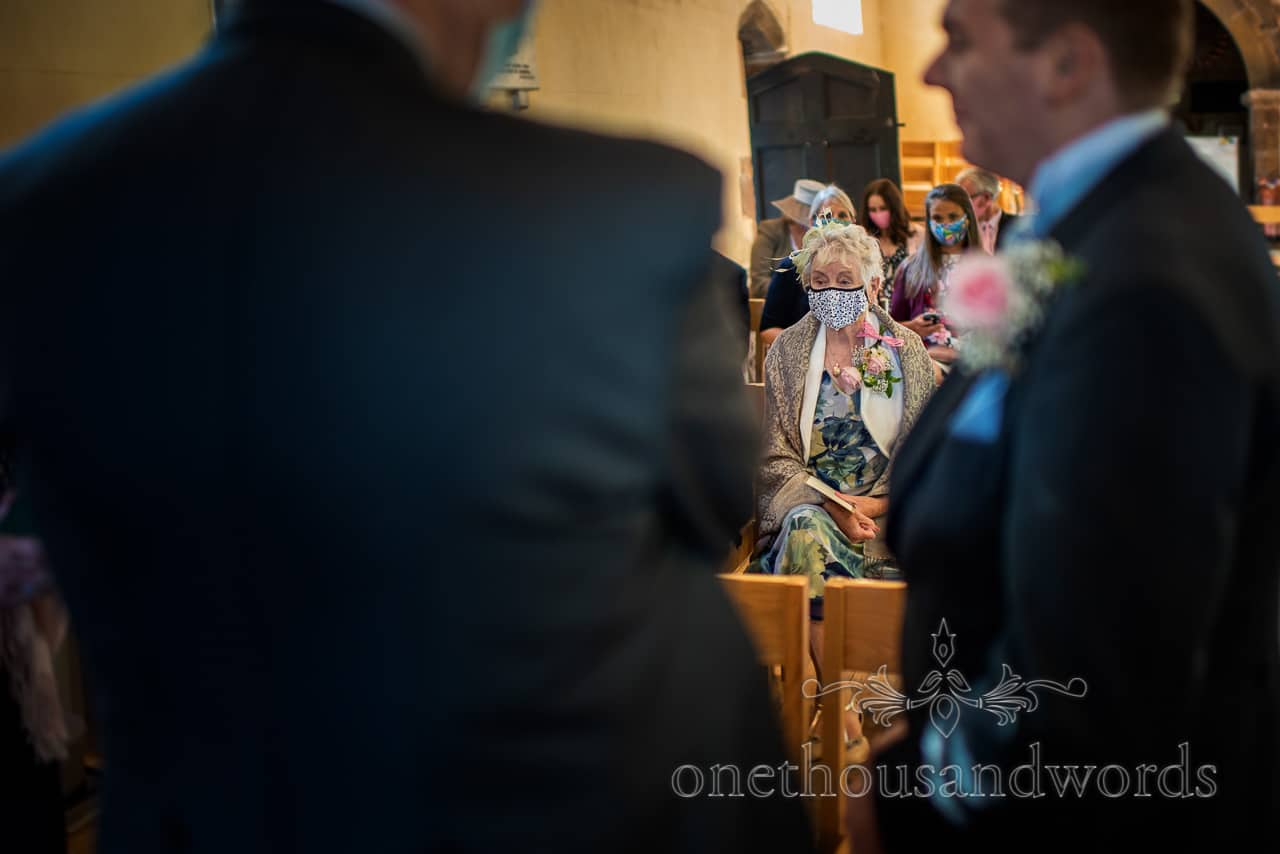 Grandma in a face mask at Covid secure church wedding ceremony