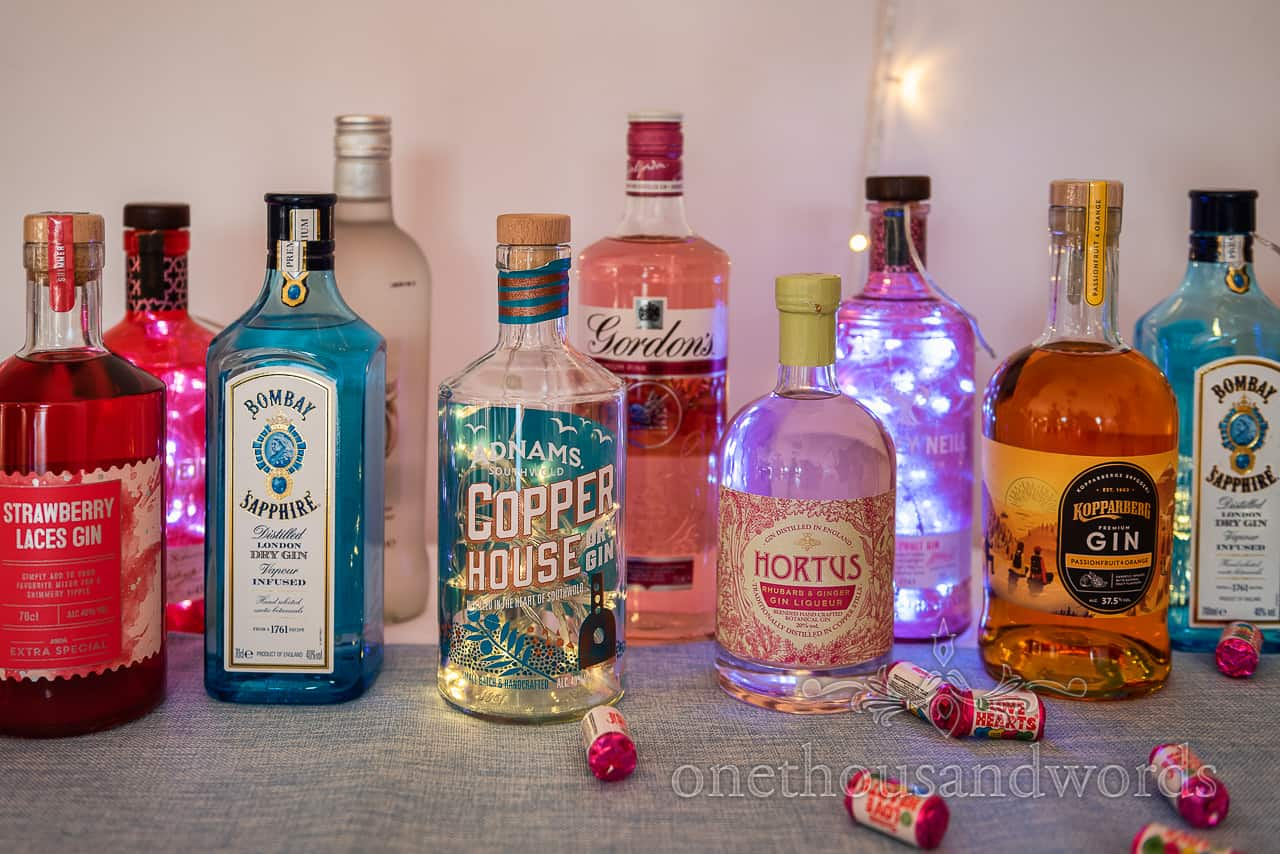 Wedding gin bar bottles with fairy lights