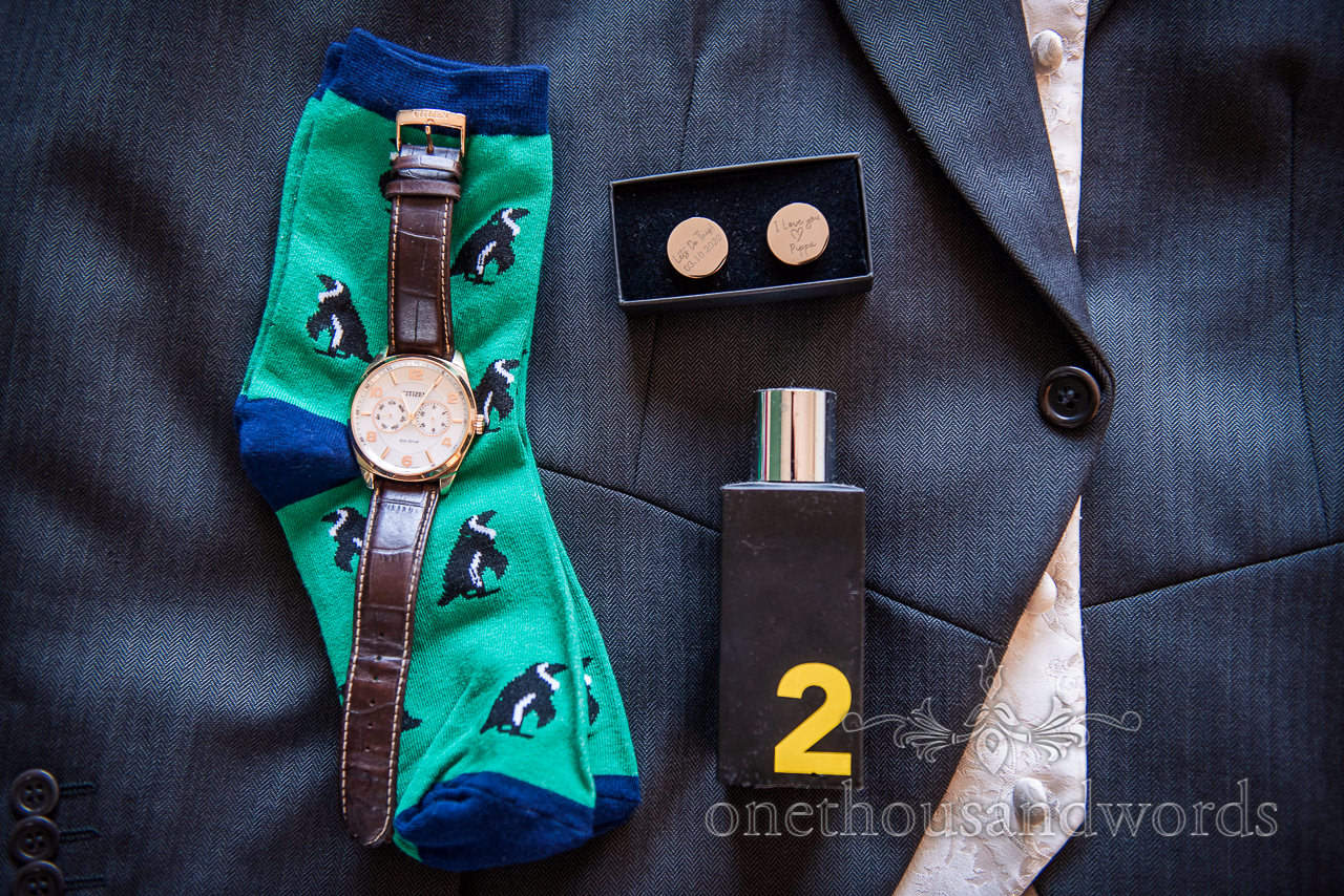 Grooms watch, penguin socks, cuff links and aftershave