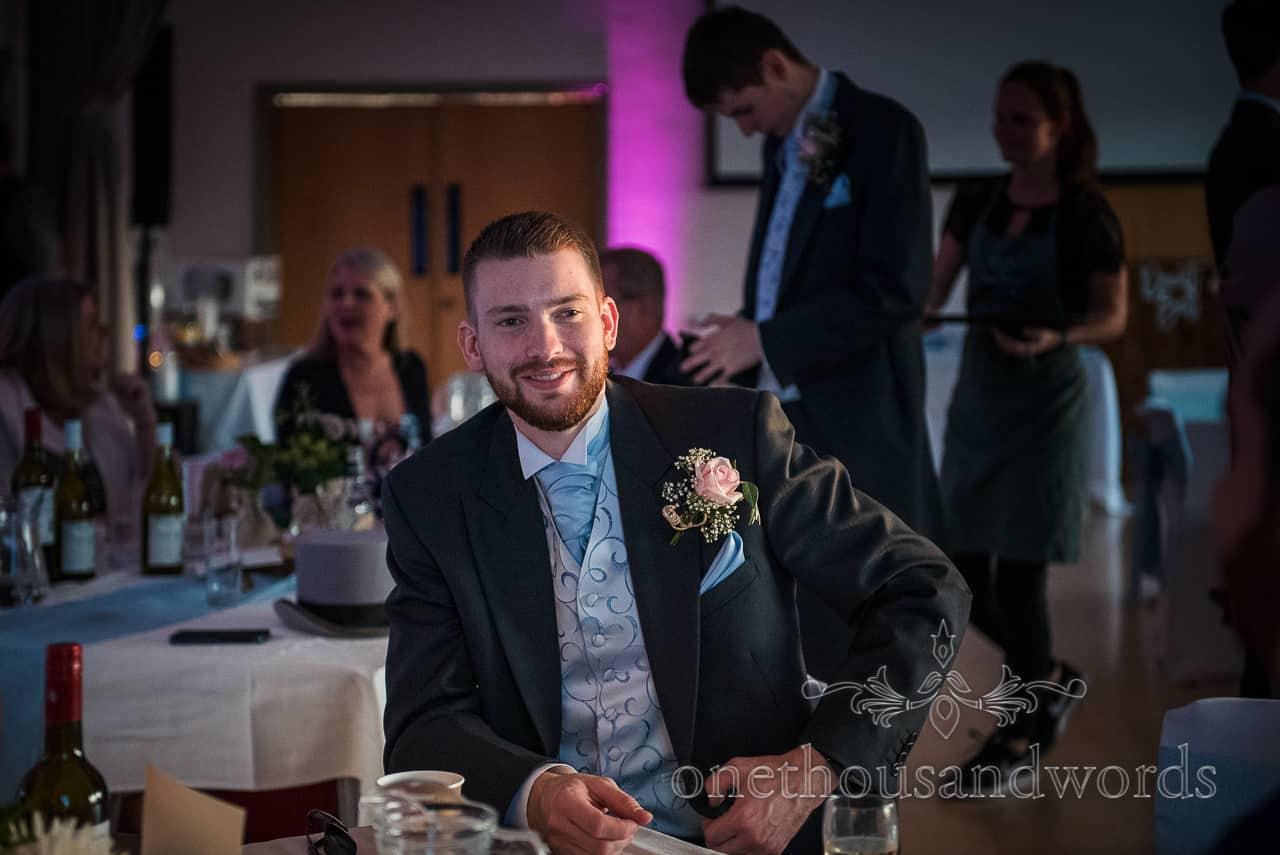 Groomsman lit by low evening light wedding portrait photograph