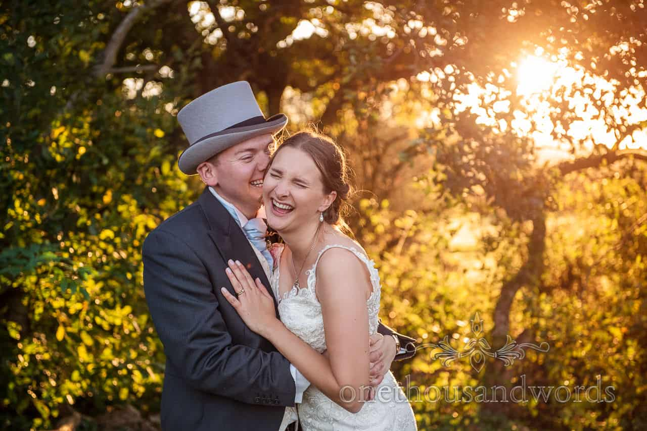 Laughing bride and groom at sunset at Village Hall wedding photographs