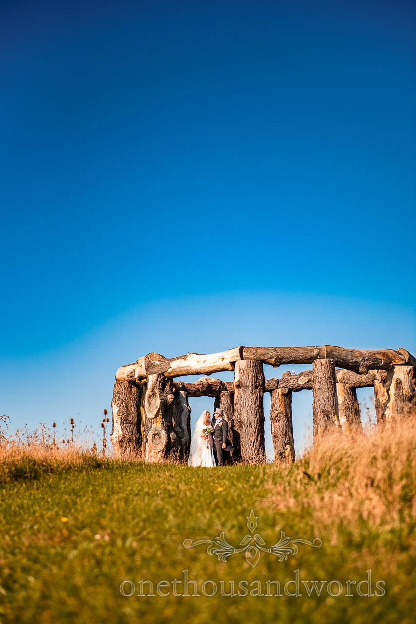 Newlyweds in wood henge in Dorset countryside