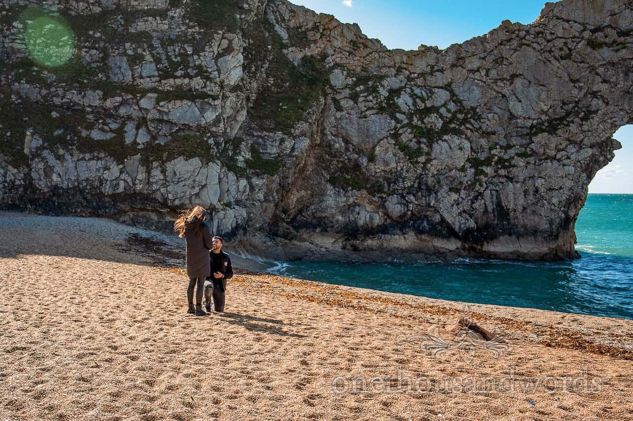 Durdledoor proposal photographs of groom on one knee