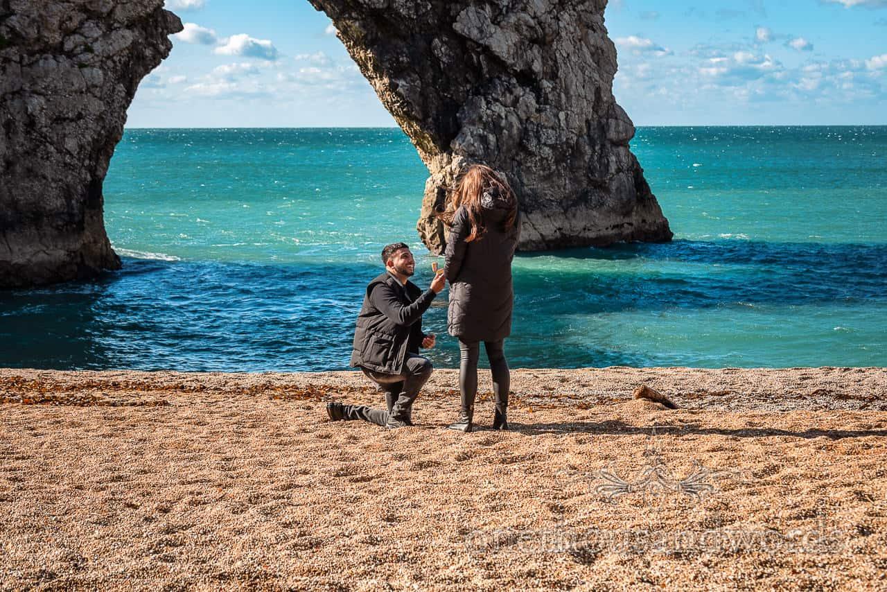 Durdledoor proposal photographs on one knee on Dorset beach