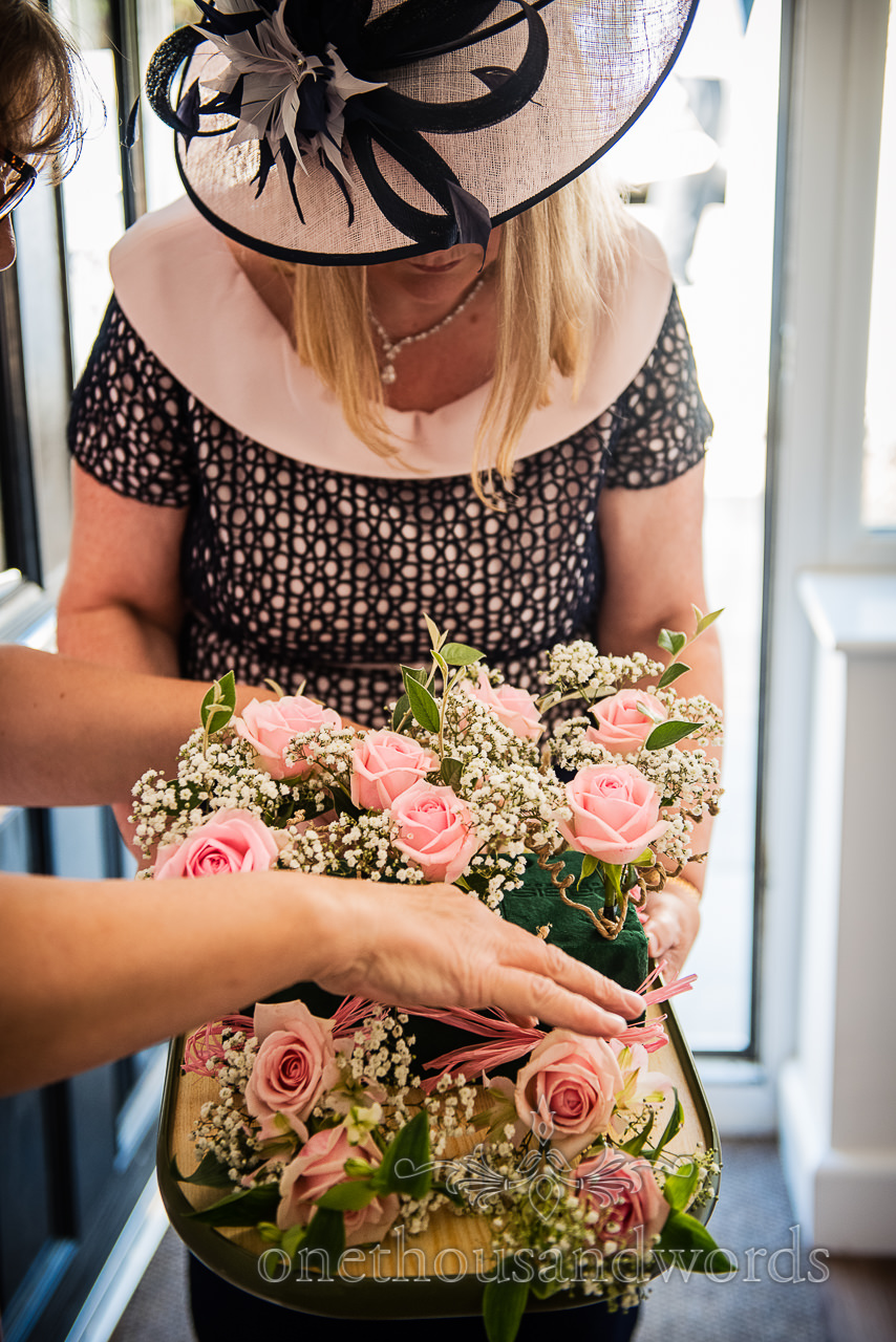 Pink rose wedding flowers arrive during bridal wedding morning