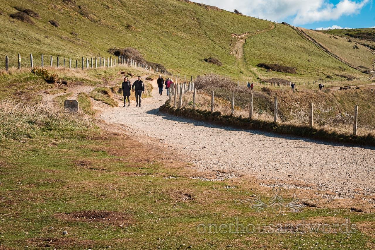 proposal photo shoot couple walk along south west coastal footpath