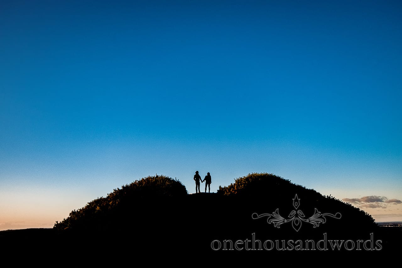 Swyre Head engagement photographs of couple in silhouette on top of hill