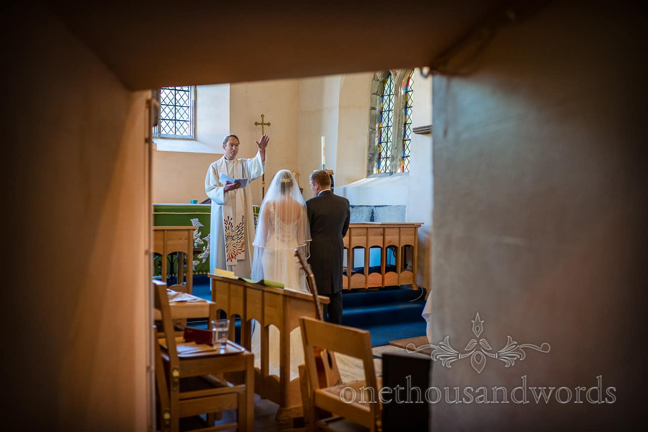 Vicar blesses the newlyweds at church wedding ceremony