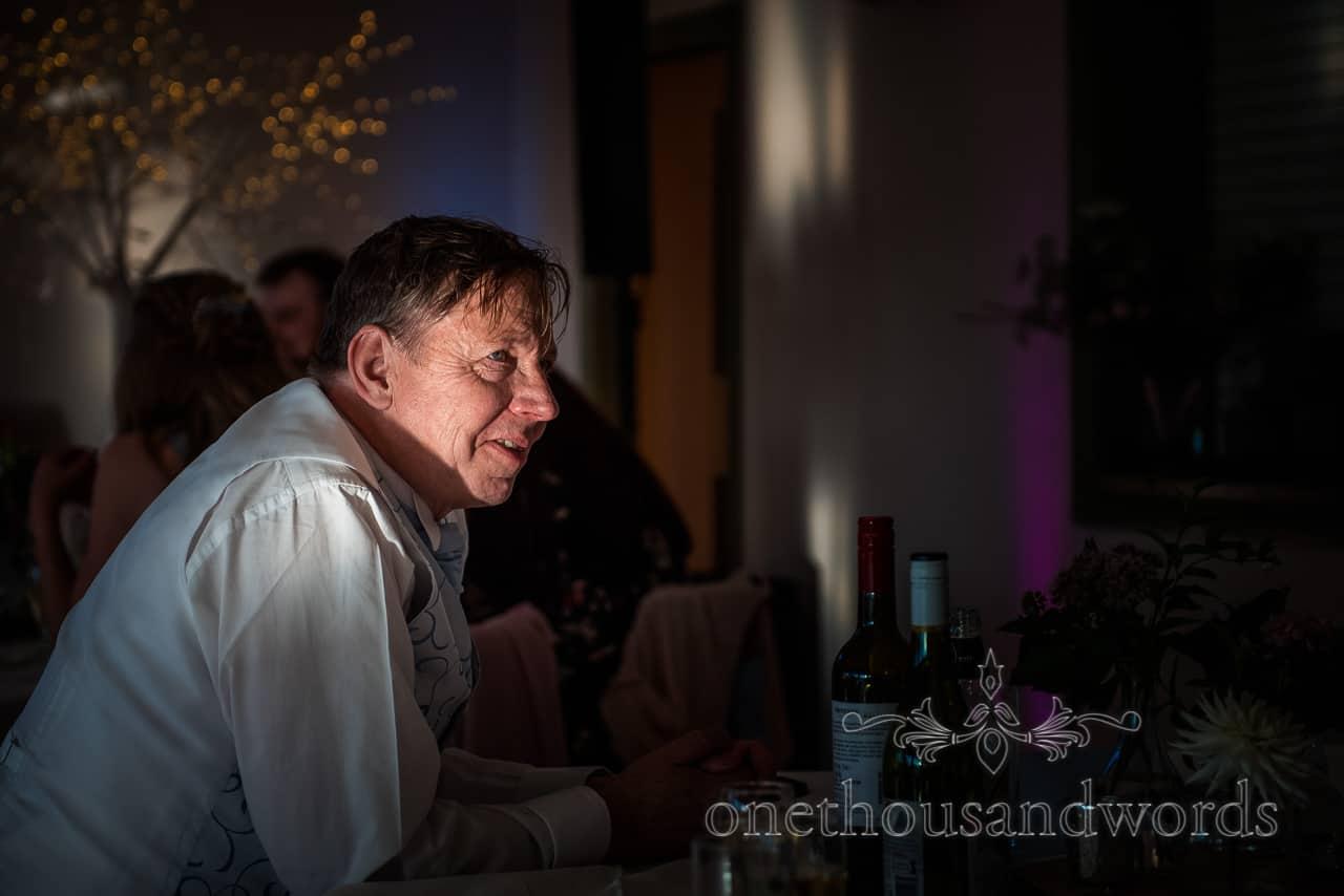 Wedding guest portrait photograph in shaft of sunlight