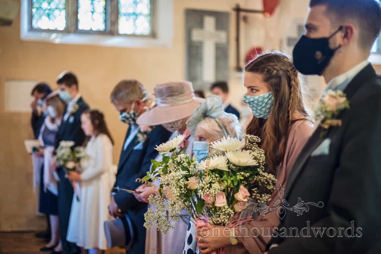 Wedding guests wear face masks at COVID secure church wedding
