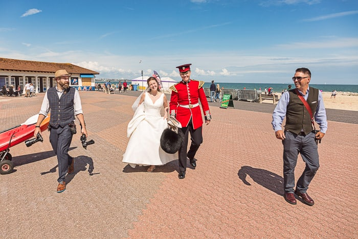 Dorset wedding photographers one thousand words with bride and groom on south coast UK beach