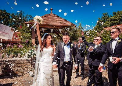 Best wedding confetti photo at Kingston Country Courtyard wedding venue in Dorset