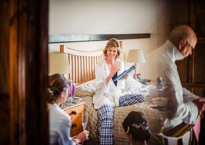 Documentary photo of bridal preparations with reflection of brides father dressing himself by one thousand words wedding photographers
