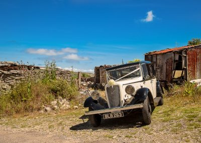 Classic wedding car parked in rural Dorset scene