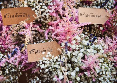 Countryside pink and white wedding flowers in labelled bridesmaids bouquets