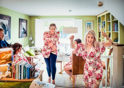Documentary wedding photo of brides party dancing during wedding morning preparations in Dorset