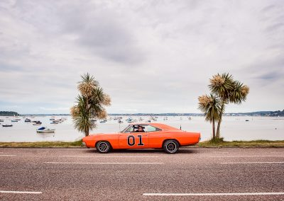 Dukes of Hazard orange car wedding transport at Poole Harbour