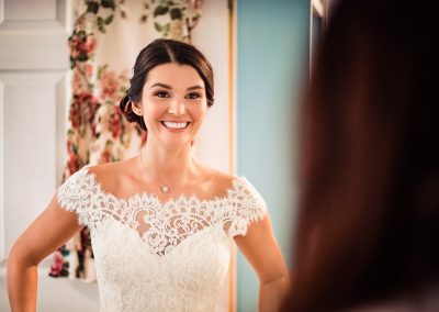 Smiling beautiful bride in white wedding dress portrait photograph by one thousand words wedding photographers