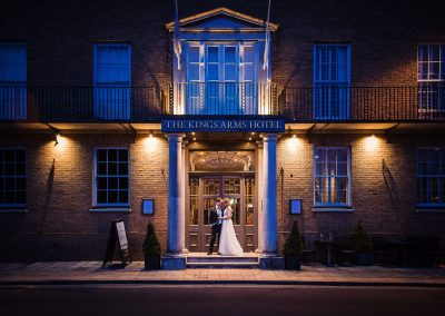 Kings Arms Hotel Christchurch with bride and groom lit blue and yellow at night