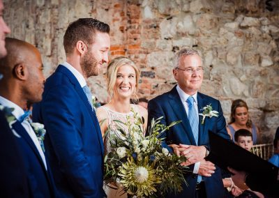 Wedding ceremony photograph at Lulworth Castle of smiling bride