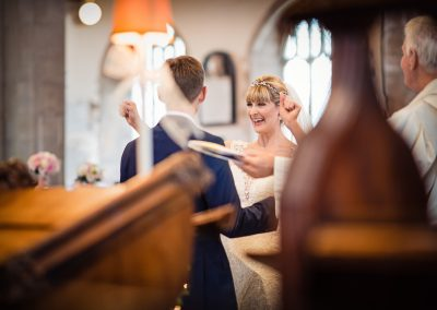 Dorset documentary wedding photographers capture bride celebrating marriage at Church ceremony