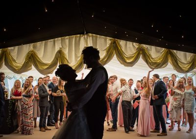 Wedding guests react to marquee secret dance floor reveal with bride and groom