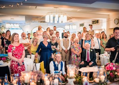 Documentary wedding photo of guests choreographed dance routine in castle wedding venue