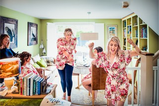 Bride and bridesmaids dancing on perfect wedding morning