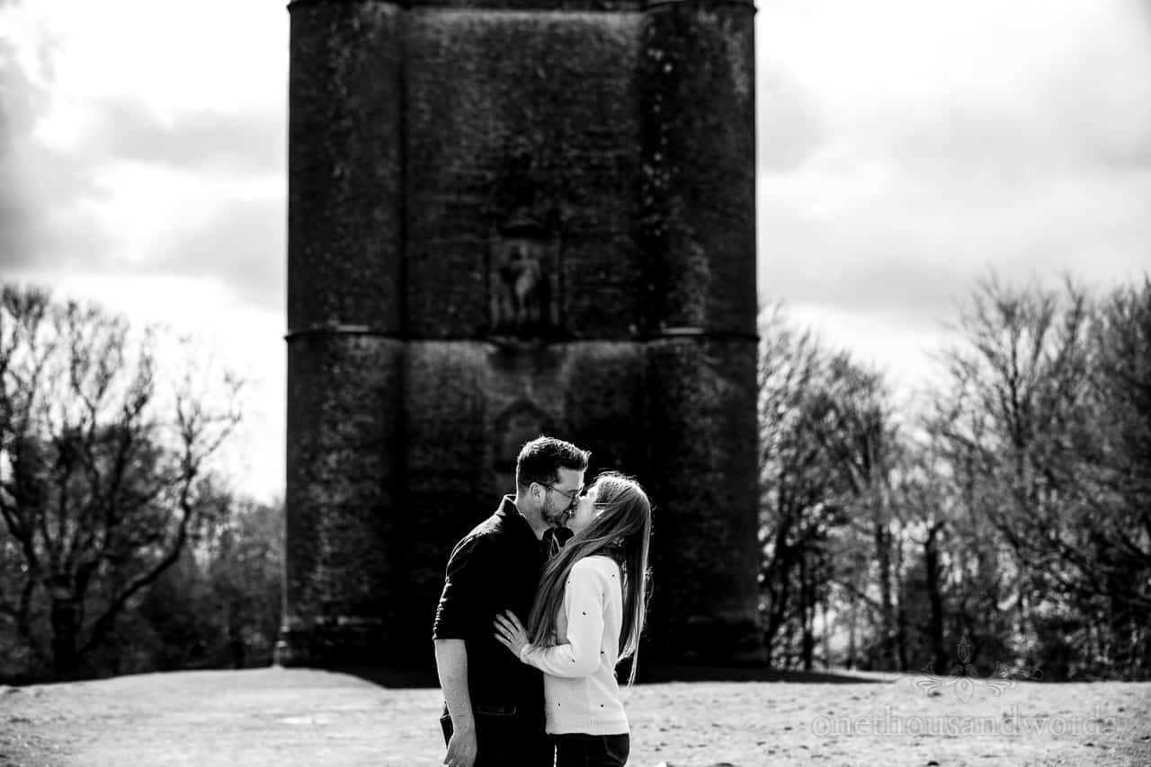 King Alfred's Tower engagement photos of couple kissing in front of folly