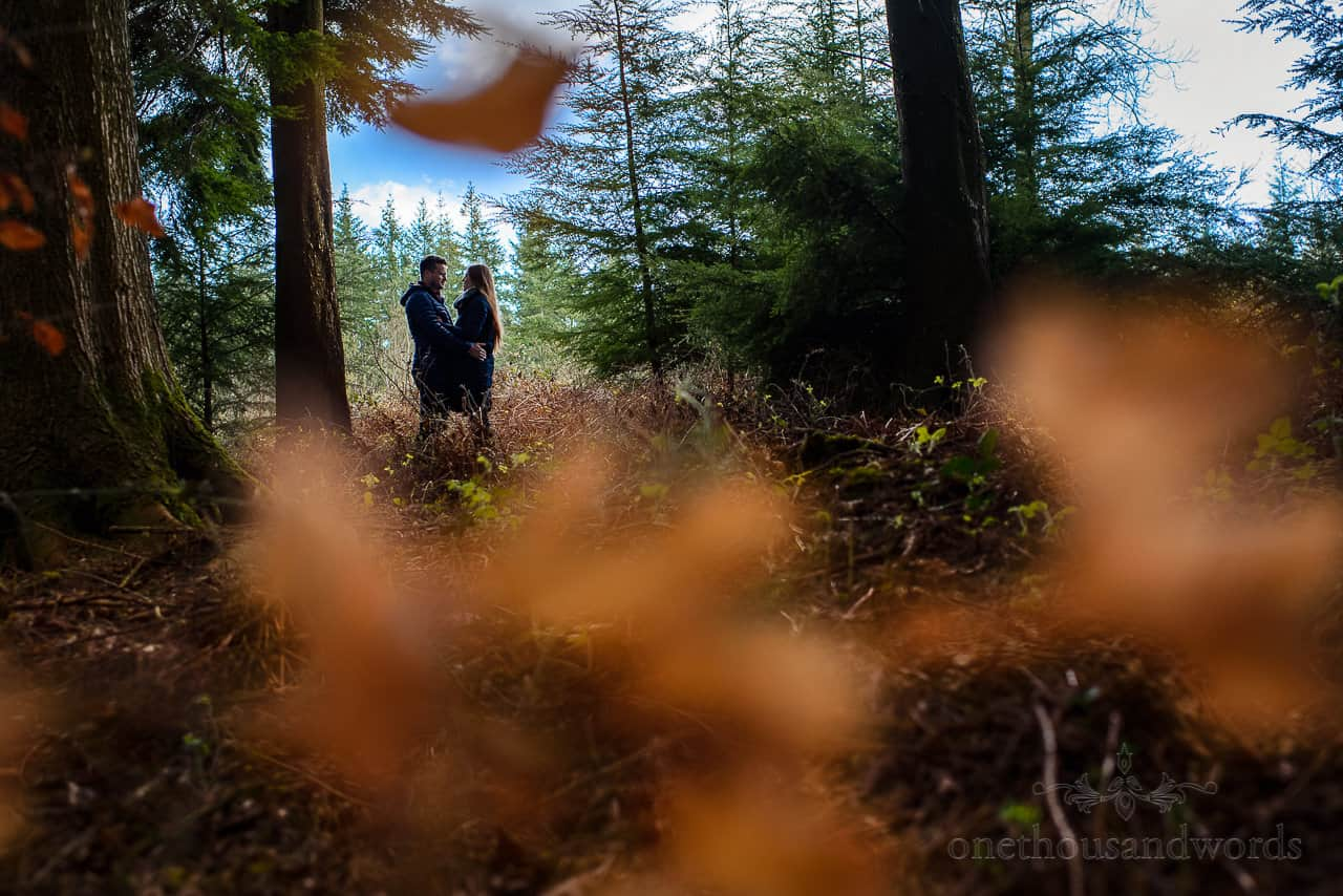 Couple photo session in Stourhead Estate woodland shadows, Wiltshire