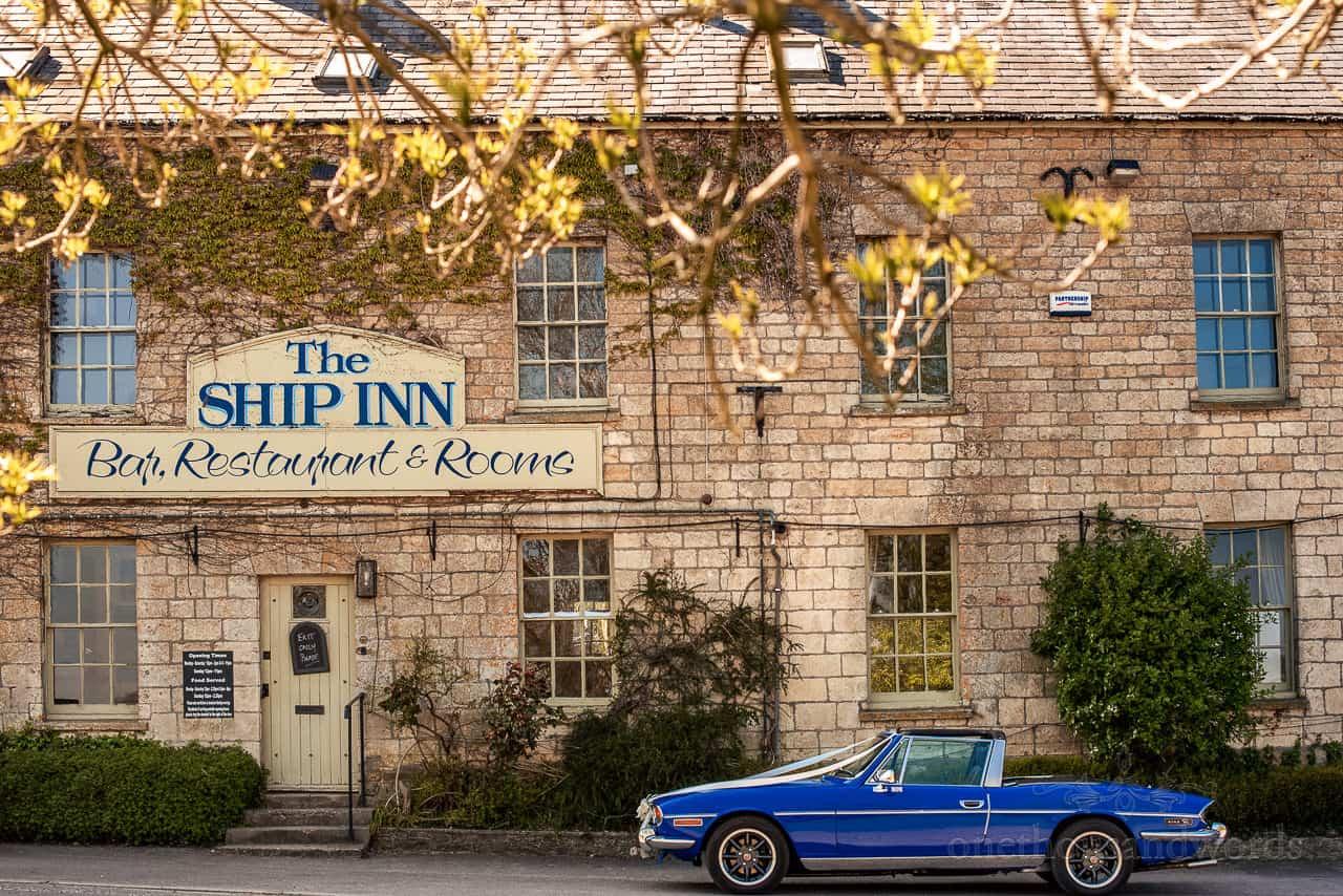 Blue triumph stag wedding car parked outside ship inn stone pub wedding venue