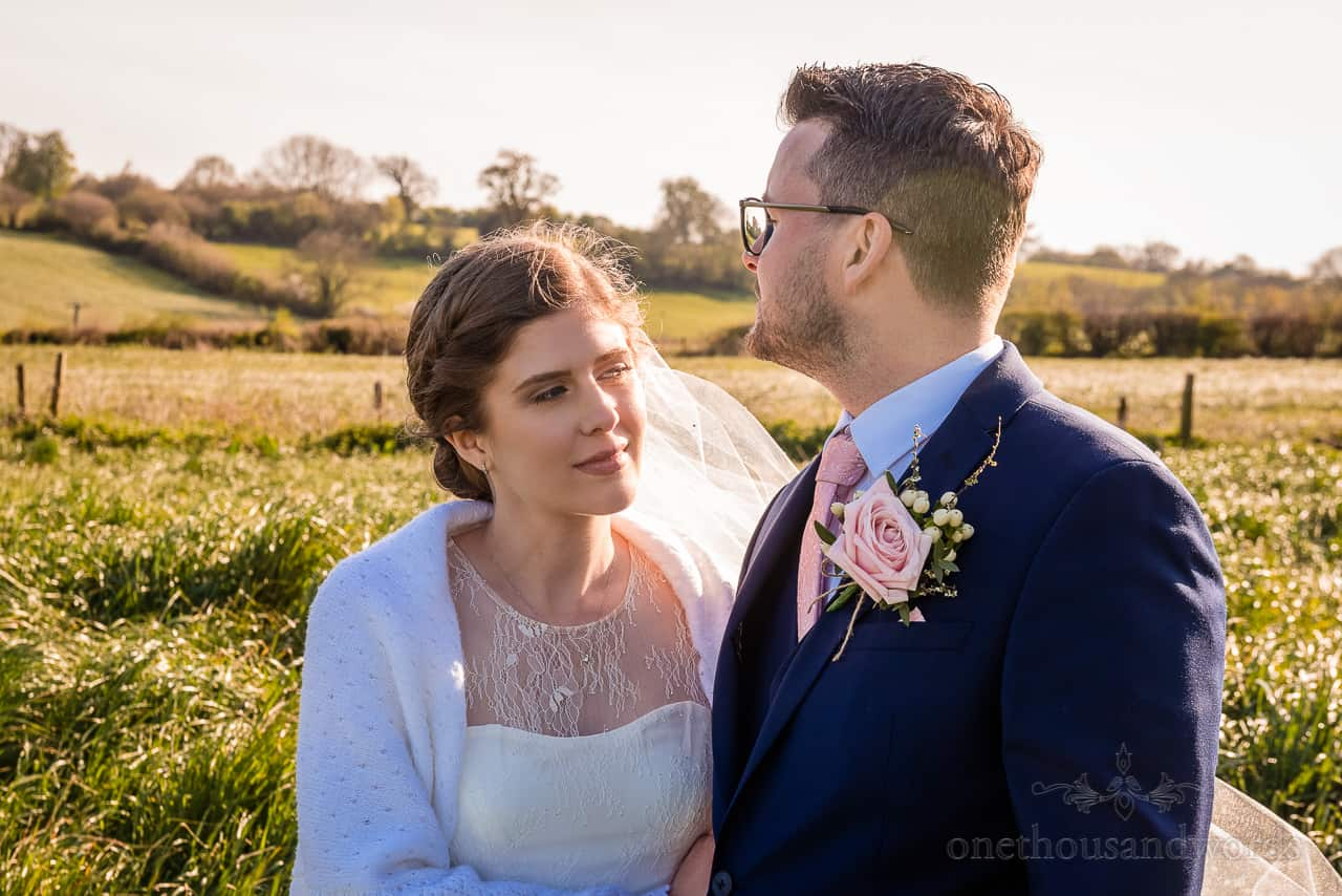 Countryside portrait couple photograph of bride and groom with low sun