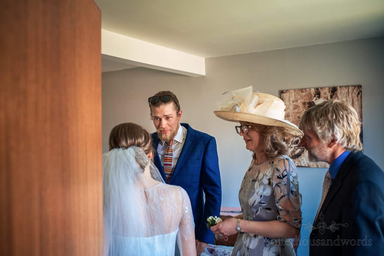 Brides brother and parents react to seeing her in wedding dress on wedding morning
