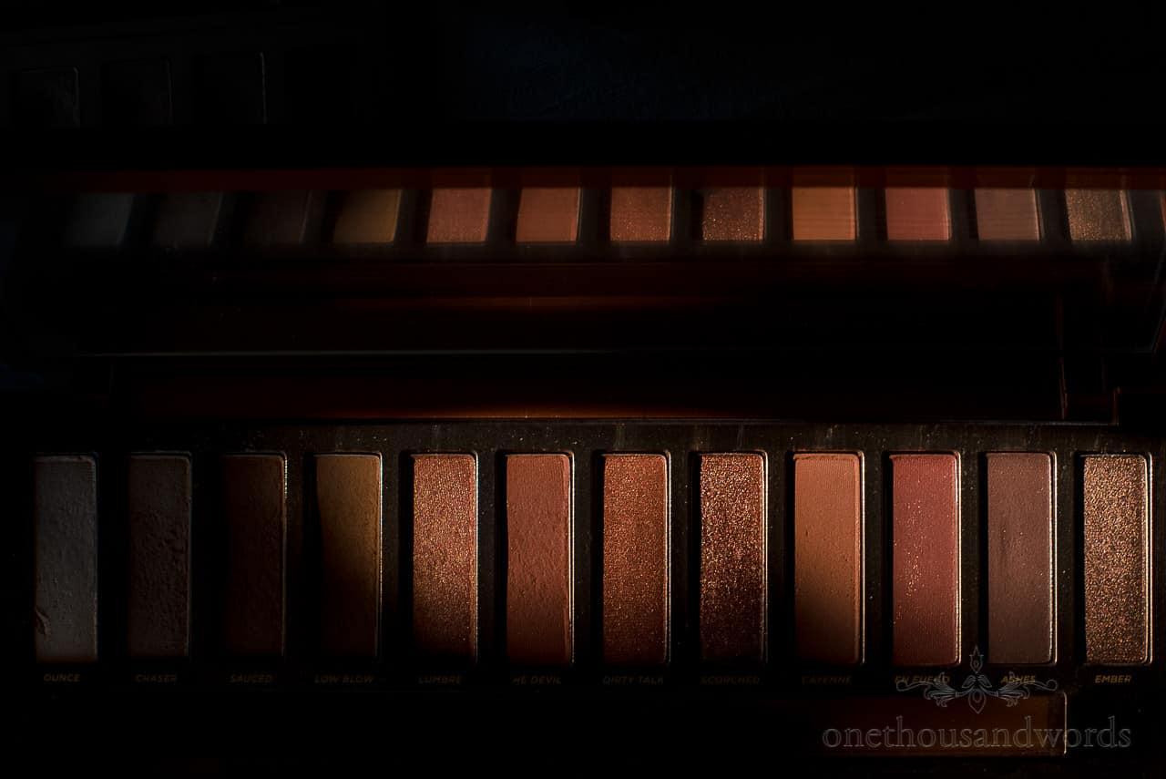 Close up photograph of light shaft on bronze shine makeup pallet