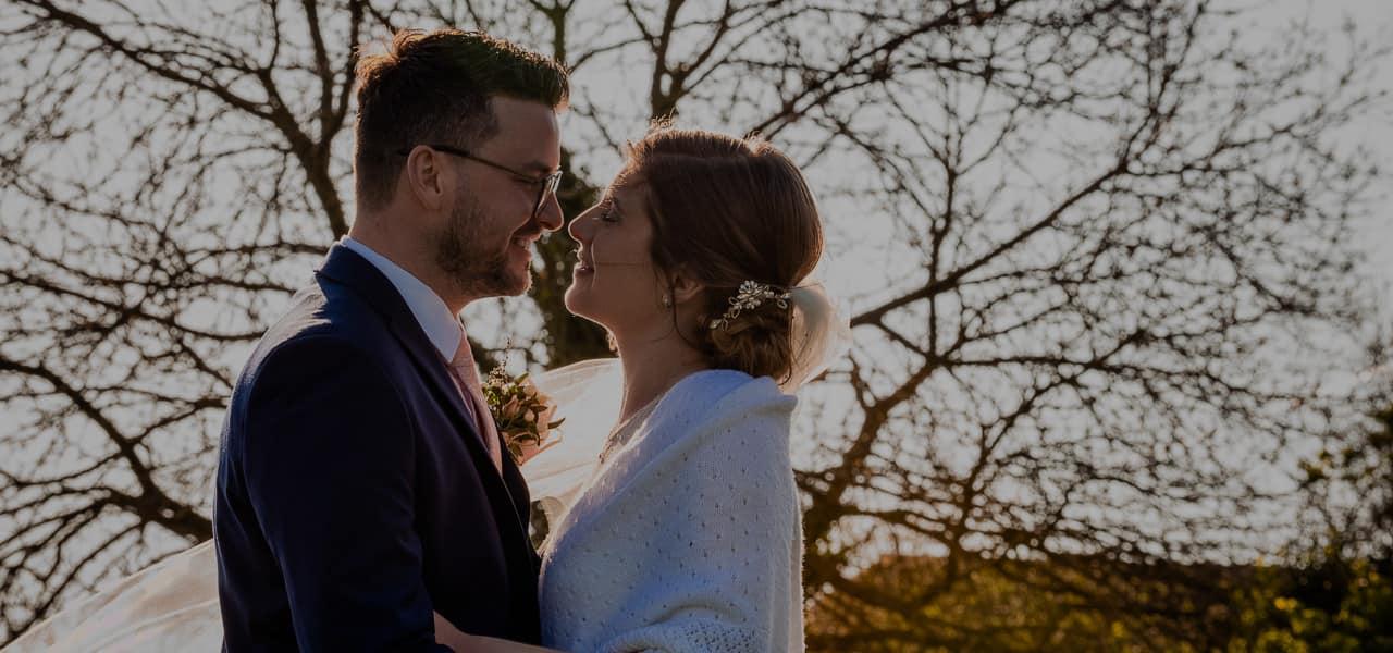 Dorset wedding photographers capture intimate wedding couple kissing in countryside