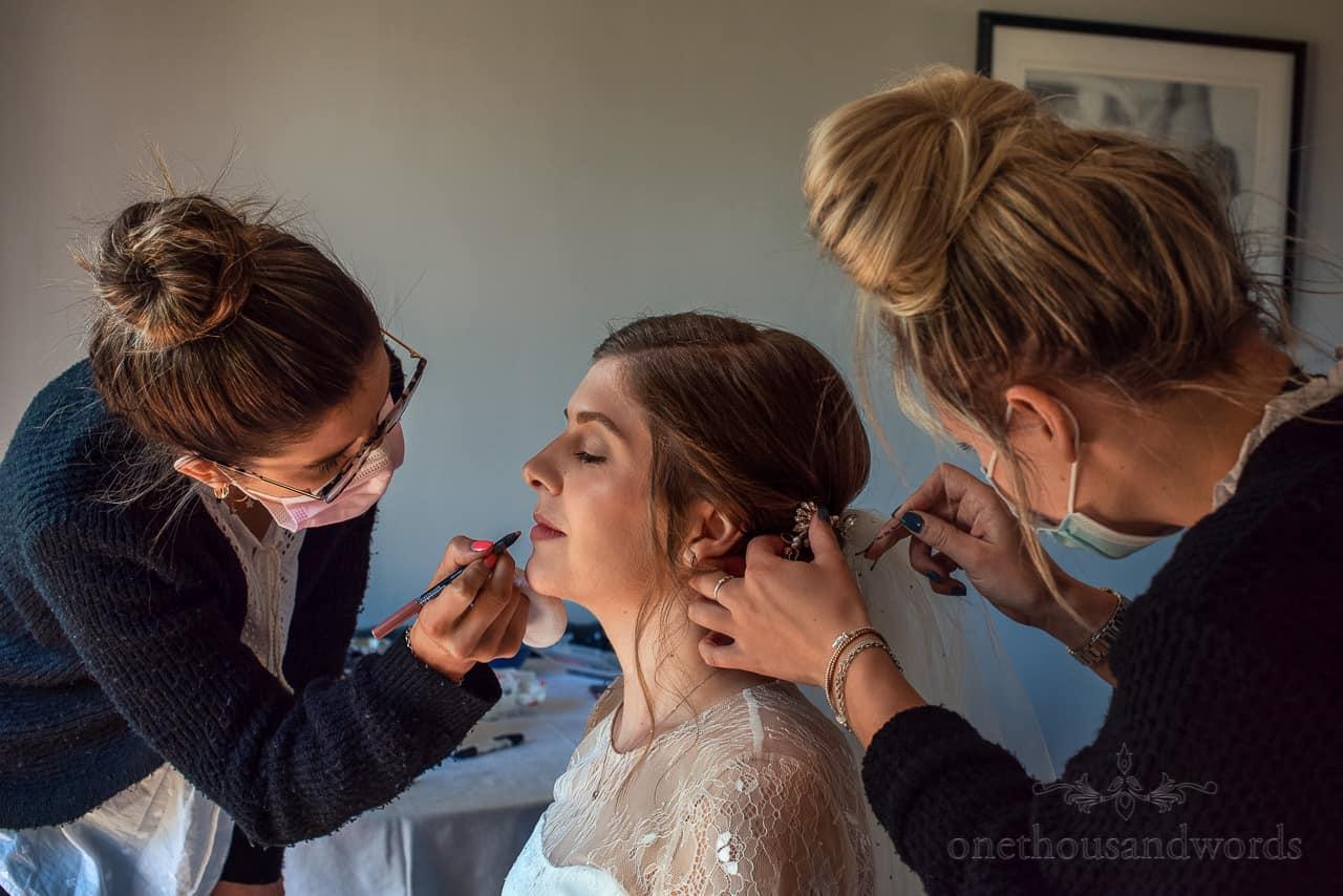 Wedding makeup artist and hair stylist tag team bride
