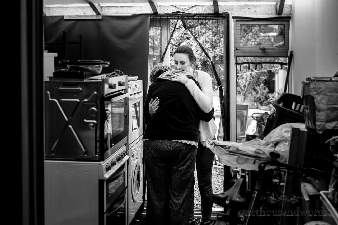 Emotional moment captured between bride and her mother on wedding morning by one thousand words documentary wedding photographers