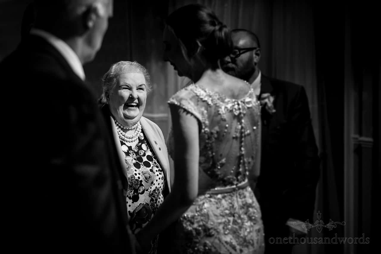 Black and white wedding portrait photograph of bride's grandmother laughing